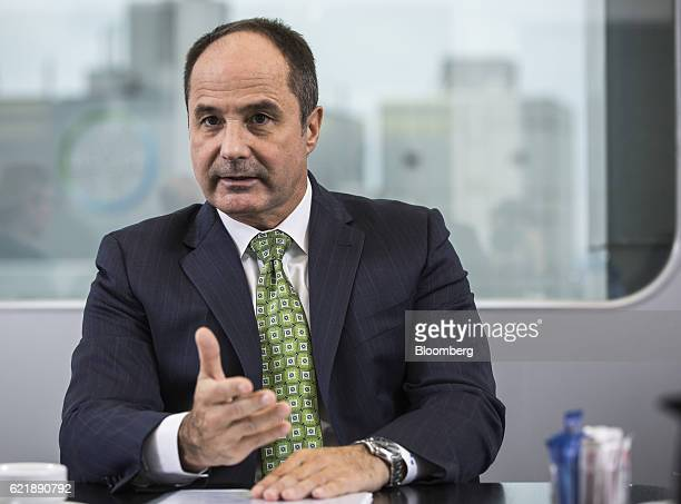Dieter Weinand chief executive officer of Bayer AG's pharmaceutical unit gestures as he speaks during an interview at Bayer's offices in Berlin...