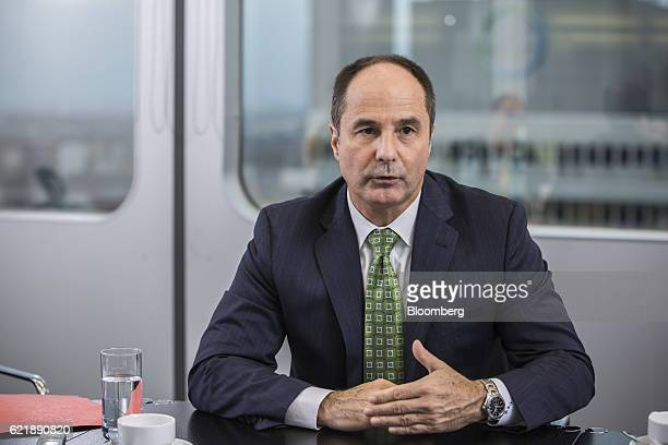 Dieter Weinand chief executive officer of Bayer AG's pharmaceutical unit speaks during an interview at Bayer's offices in Berlin Germany on Tuesday...
