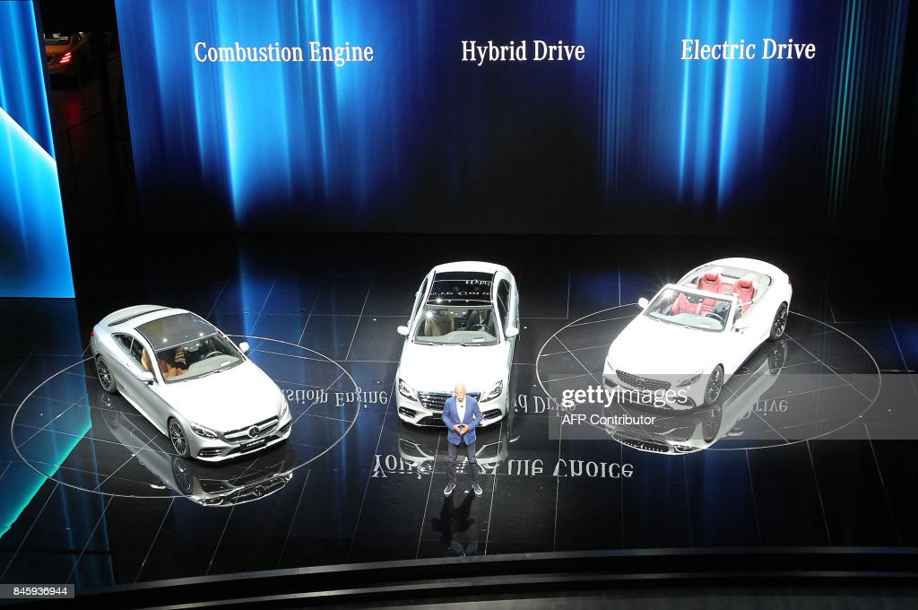 Dieter Zetsche, CEO of Daimler, presents the Mercedes S Models at the Frankfurt Motor Show IAA in Frankfurt am Main, western Germany, on September 12, 2017. According to organisers, around 1,000 exhibitors from 39 countries will showcase their products and services. This year's fair running from September 14 to 24, 2017 will focus on digitization, urban mobility and electric mobility. / AFP PHOTO / Daniel ROLAND