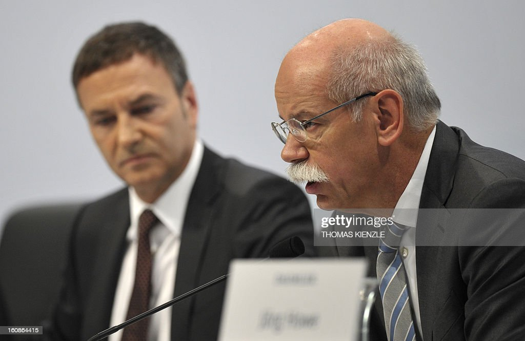 Dieter Zetsche (R), CEO of German auto giant Daimler addresses the company's annual press conference in Stuttgart, southwestern Germany, on February 7, 2013. German automaker Daimler said Thursday that its net profit rose by 8,0 percent to 6,495 billion euros ($8,8 billion) in 2012 on the back of record unit sales and revenues. AFP PHOTO / THOMAS KIENZLE