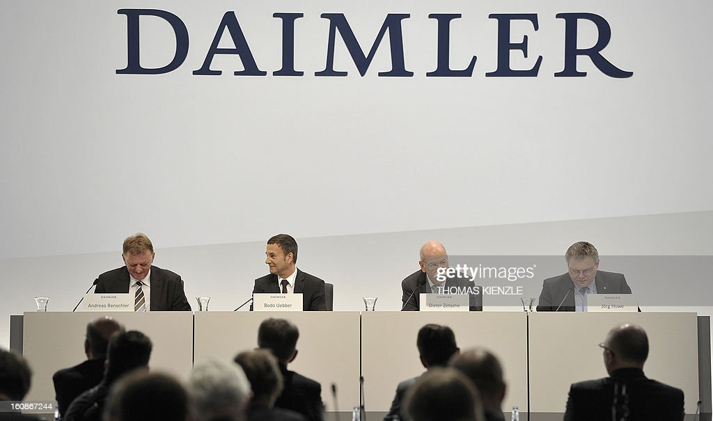 Dieter Zetsche (2nd R) CEO of German auto giant Daimler, adresses journalists flanked by (L-R) board members Andreas Renschler and Bodo Uebber, member of the board for finances and Joerg Howe (R), spokesman of German auto giant Daimler during the company's annual press conference in Stuttgart, southwestern Germany, on February 7, 2013. German automaker Daimler said Thursday that its net profit rose by 8,0 percent to 6,495 billion euros ($8,8 billion) in 2012 on the back of record unit sales and revenues.