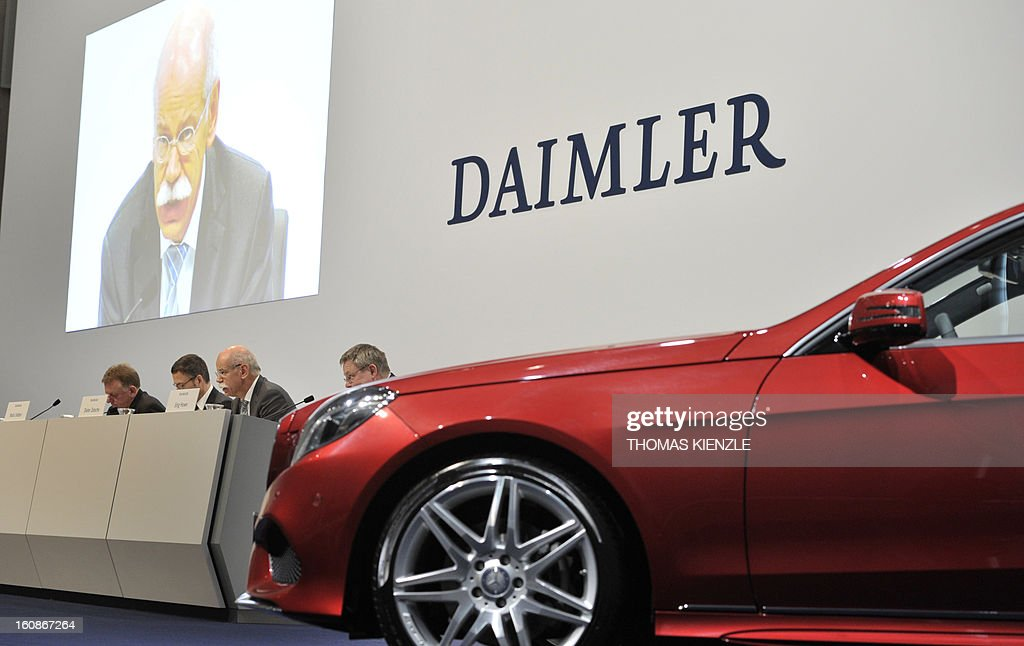 Dieter Zetsche, CEO of German auto giant Daimler, is displayed on a screen as he adresses journalists during the company's annual press conference in Stuttgart, southwestern Germany, on February 7, 2013. Daimler said that its net profit rose by 8.0 percent to 6.495 billion euros ($8.8 billion) in 2012 on the back of record unit sales and revenues.