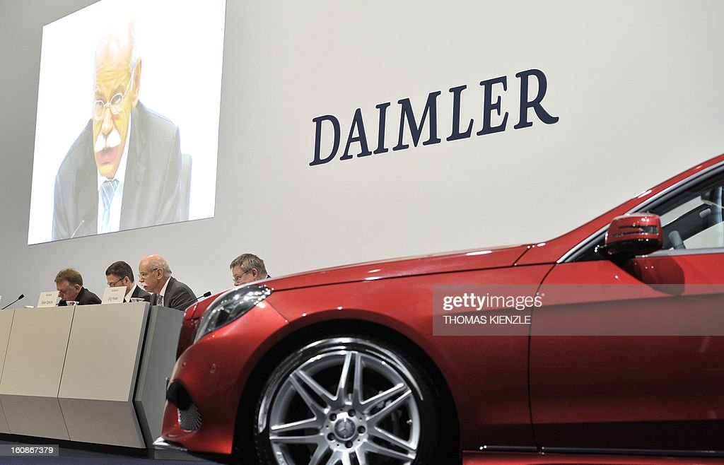 Dieter Zetsche, CEO of German auto giant Daimler, is displayed on a screen as he addresses journalists during the company's annual press conference in Stuttgart, southern Germany on February 7, 2013. German automaker Daimler said Thursday that its net profit rose by 8,0 percent to 6,495 billion euros ($8,8 billion) in 2012 on the back of record unit sales and revenues. AFP PHOTO / THOMAS KIENZLE