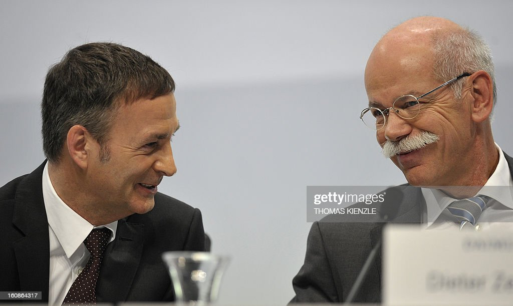 Dieter Zetsche (R), CEO of German auto giant Daimler, talks with Bodo Uebber (L), member of the board for finances, during the company's annual press conference in Stuttgart, southwestern Germany, on February 7, 2013. German automaker Daimler said Thursday that its net profit rose by 8,0 percent to 6,495 billion euros ($8,8 billion) in 2012 on the back of record unit sales and revenues. AFP PHOTO / THOMAS KIENZLE