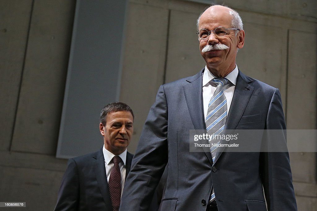 Dieter Zetsche (R), CEO of German carmaker Daimler AG, and member of the board for finances, Bodo Uebber (L) arrive to the media to announce the company's financial performance in 2012 during the Daimler AG, annual press conference on February 7, 2013 in Stuttgart, Germany. Daimler, which manufactures Mercedes-Benz luxury cars, finished in 2012 with its highest business volume of 114.3 Billion Euro since ending its merger with Chrysler in 2007. The group announced a EBIT from ongoing business of 8.6 Billion Euro.