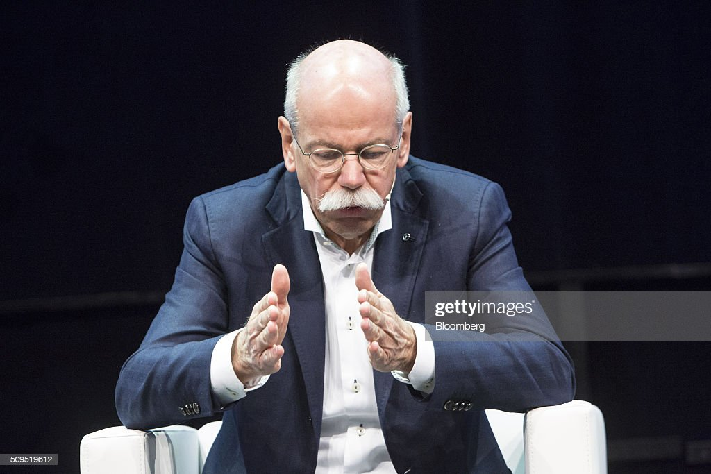 Dieter Zetsche, chief executive officer of Daimler AG, gestures during a panel discussion at the CAR Symposium in Bochum, Germany, on Thursday, Feb. 11, 2016. General Motors Co.'s German brand Opel will introduce its first fully electric car next year as part of a 29-model lineup overhaul, putting pressure on Volkswagen AG as it reels from the diesel-emissions scandal. Photographer: Martin Leissl/Bloomberg via Getty Images