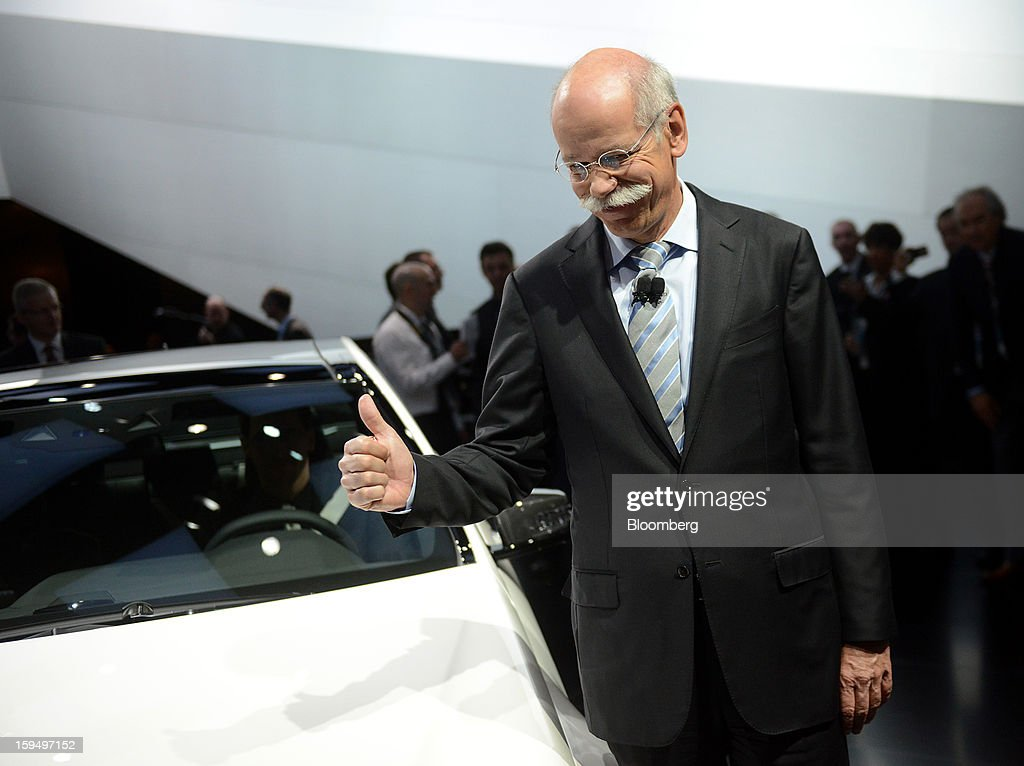 """Dieter Zetsche, chief executive officer of Daimler AG, gives a thumbs up while standing for a photograph during the 2013 North American International Auto Show (NAIAS) in Detroit, Michigan, U.S., on Monday, Jan. 14, 2013. Zetsche said the European car market will probably """"slightly decline"""" in the first half of the year. Photographer: Daniel Acker/Bloomberg via Getty Images"""