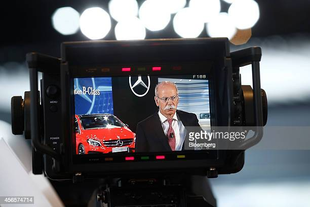 Dieter Zetsche chief executive officer of Daimler AG is seen through a television camera lens as he prepares for an interview during the preview day...