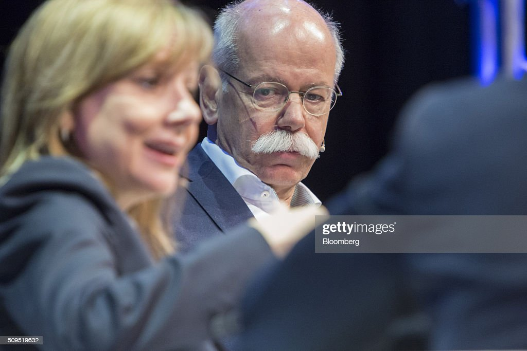 Dieter Zetsche, chief executive officer of Daimler AG, looks on as Mary Barra, chief executive officer of General Motors Co. (GM), speaks during a panel discussion at the CAR Symposium in Bochum, Germany, on Thursday, Feb. 11, 2016. GM's German brand Opel will introduce its first fully electric car next year as part of a 29-model lineup overhaul, putting pressure on Volkswagen AG as it reels from the diesel-emissions scandal. Photographer: Martin Leissl/Bloomberg via Getty Images