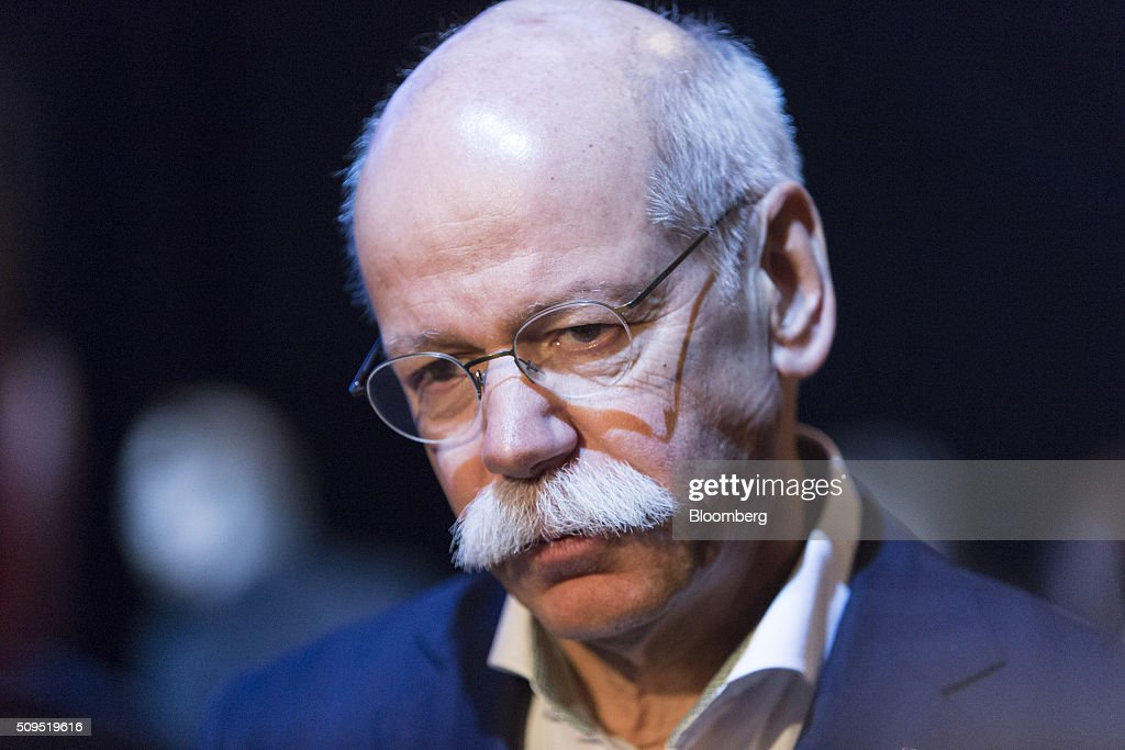 Dieter Zetsche, chief executive officer of Daimler AG, pauses while speaking to reporters during the CAR Symposium in Bochum, Germany, on Thursday, Feb. 11, 2016. General Motors Co.'s German brand Opel will introduce its first fully electric car next year as part of a 29-model lineup overhaul, putting pressure on Volkswagen AG as it reels from the diesel-emissions scandal. Photographer: Martin Leissl/Bloomberg via Getty Images