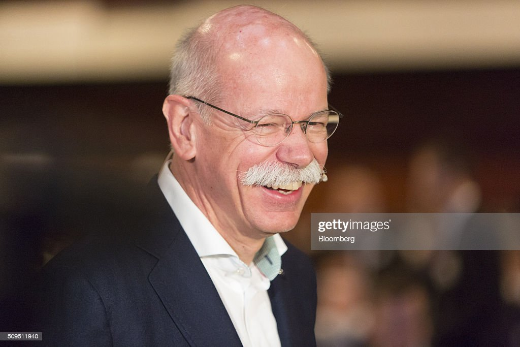 Dieter Zetsche, chief executive officer of Daimler AG, reacts during the CAR Symposium in Bochum, Germany, on Thursday, Feb. 11, 2016. General Motors Co.'s German brand Opel will introduce its first fully electric car next year as part of a 29-model lineup overhaul, putting pressure on Volkswagen AG as it reels from the diesel-emissions scandal. Photographer: Martin Leissl/Bloomberg via Getty Images