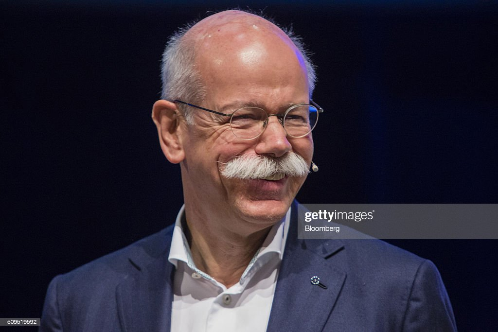 <a gi-track='captionPersonalityLinkClicked' href=/galleries/search?phrase=Dieter+Zetsche&family=editorial&specificpeople=241297 ng-click='$event.stopPropagation()'>Dieter Zetsche</a>, chief executive officer of Daimler AG, reacts during the CAR Symposium in Bochum, Germany, on Thursday, Feb. 11, 2016. General Motors Co.'s German brand Opel will introduce its first fully electric car next year as part of a 29-model lineup overhaul, putting pressure on Volkswagen AG as it reels from the diesel-emissions scandal. Photographer: Martin Leissl/Bloomberg via Getty Images