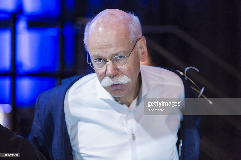 Dieter Zetsche, chief executive officer of Daimler AG, removes his jacket during the CAR Symposium in Bochum, Germany, on Thursday, Feb. 11, 2016. General Motors Co.'s German brand Opel will introduce its first fully electric car next year as part of a 29-model lineup overhaul, putting pressure on Volkswagen AG as it reels from the diesel-emissions scandal. Photographer: Martin Leissl/Bloomberg via Getty Images