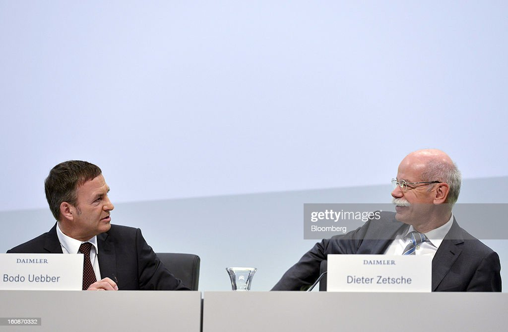 Dieter Zetsche, chief executive officer of Daimler AG, right, speaks with Bodo Uebber, chief financial officer of Daimler AG, ahead of a news conference to announce the company's results in Stuttgart, Germany, on Thursday, Feb. 7, 2013. Daimler AG, the world's third-largest maker of luxury vehicles, forecast unchanged 2013 profit as spending for new models and a revamp of the automaker's operations eat into earnings. Photographer: Guenter Schiffmann/Bloomberg via Getty Images