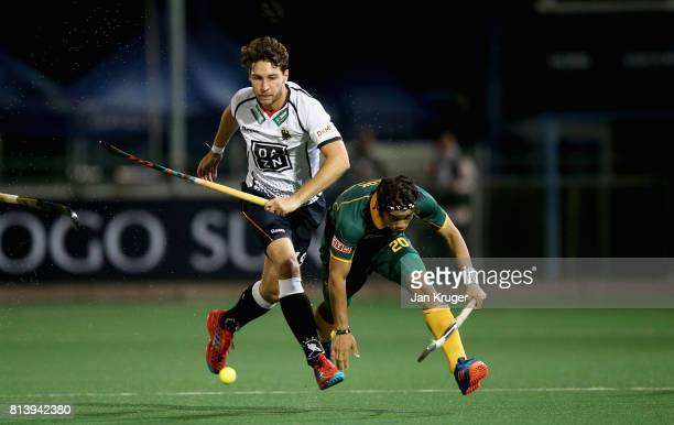 DieterEnrique Linnekogel of Germany and Tevin Kok of South Africa battle for possession during day 3 of the FIH Hockey World League Semi Finals Pool...