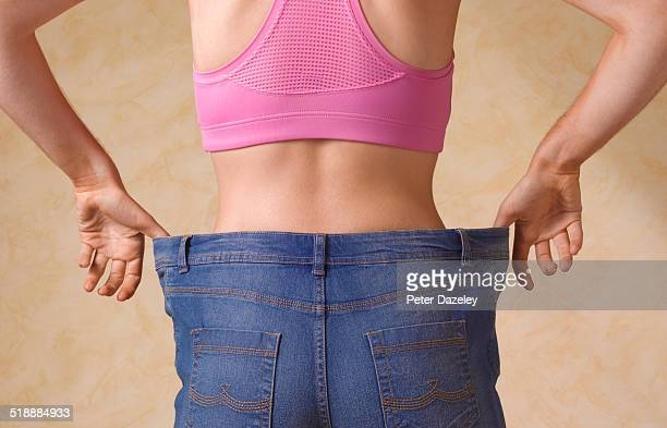 Dieting woman in jeans too large
