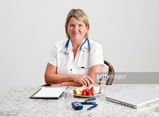 Dietitian, doctor or nurse with diabetes devices and food