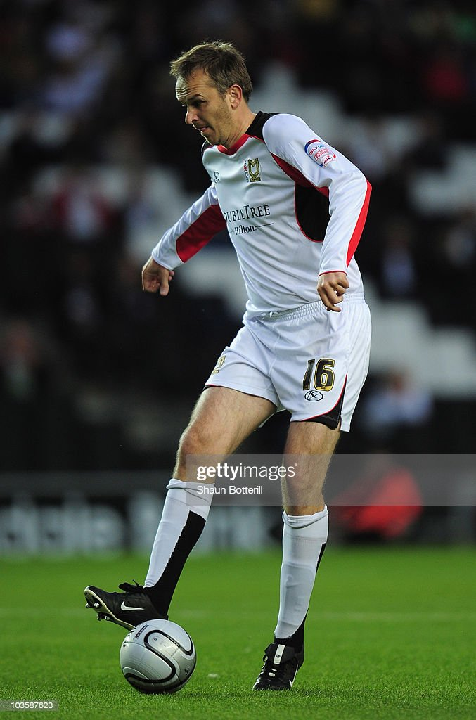 <a gi-track='captionPersonalityLinkClicked' href=/galleries/search?phrase=Dietmar+Hamann&family=editorial&specificpeople=204639 ng-click='$event.stopPropagation()'>Dietmar Hamann</a> of MK Dons controls the ball during the Carling Cup 2nd Round match between MK Dons and Blackpool at Stadium MK on August 24, 2010 in Milton Keynes, England.