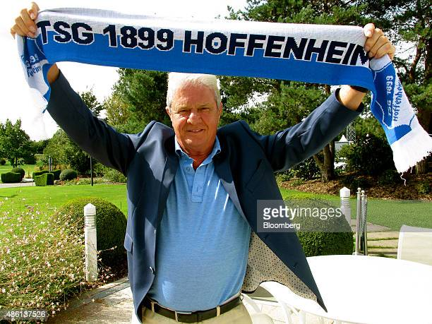Dietmar Hopp German billionaire and cofounder of SAP SE poses for a photograph holding a supporters scarf for the German soccer club TSG 1988...