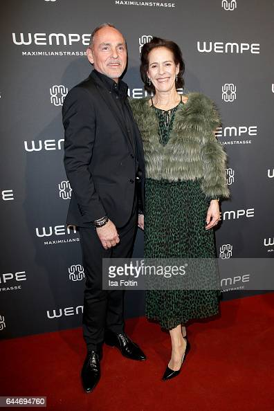 Dietmar Schuelein and KimEva Wempe attend the Wempe store opening with the Rolls Royce shuttels in front of the store on February 23 2017 in Munich...