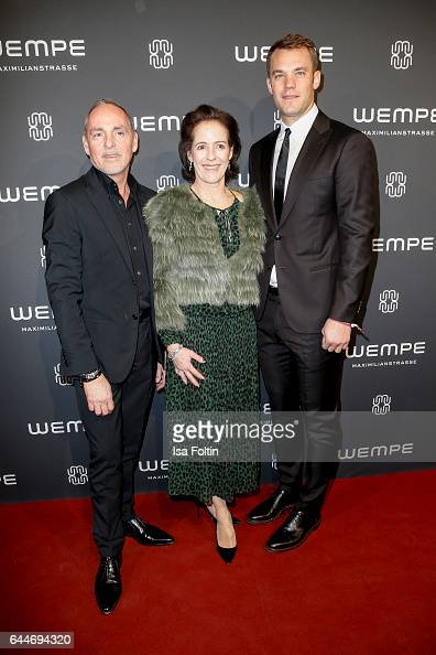 Dietmar Schuelein KimEva Wempe and Manuel Neuer goal keeper of the german soccer team attend the Wempe store opening on February 23 2017 in Munich...