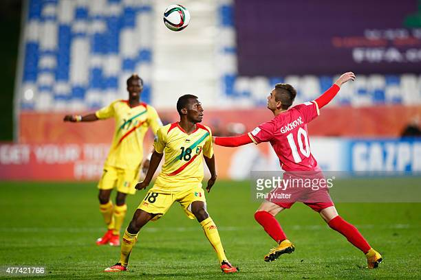 Dieudonne Gbakle of Mali and Mijat Gacinovic of Serbia header the ball during the FIFA U20 World Cup Semi Final match between Serbia and Mali at...