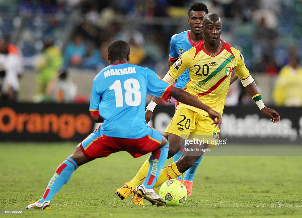 AFRICA - JANUARY 28, Dieudonne Mbokani Bezua of DR Congo and Samba Diakite of Mali during the 2013 Orange African Cup of Nations match between DR Congo and Mali from Moses Mabhida Stadium on January 28, 2013 in Durban, South Africa.