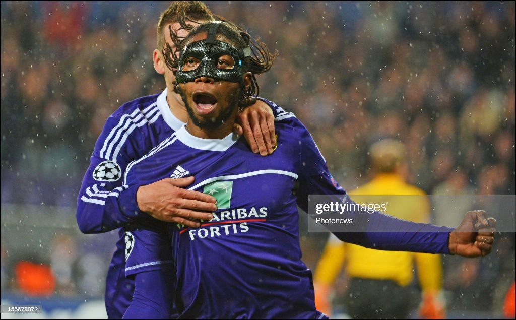 Dieudonne Mbokani of RSC Anderlecht (R) celebrates after scoring the opening goal of the UEFA Champions League Group C match between RSC Anderlecht and FC Zenit St Petersburg at the Constant Vanden Stock Stadium on November 6, 2012 in Brussels, Belgium.