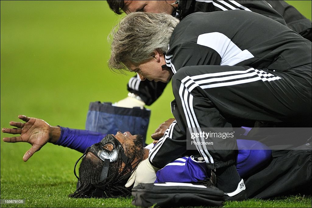 Dieudonne Mbokani of RSC Anderlecht lies injured on the pitch during the UEFA Champions League Group C match between RSC Anderlecht and FC Zenit St Petersburg at the Constant Vanden Stock Stadium on November 6, 2012 in Brussels, Belgium.