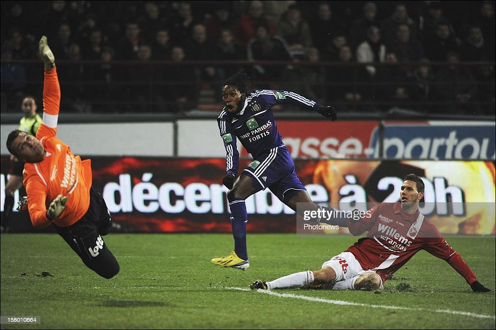 Dieudonne Mbokani of RSC Anderlecht scores during the Jupiler League match between RAEC MONS vs RSC Anderlecht on December 08 , 2012 in Mons, Belgium.