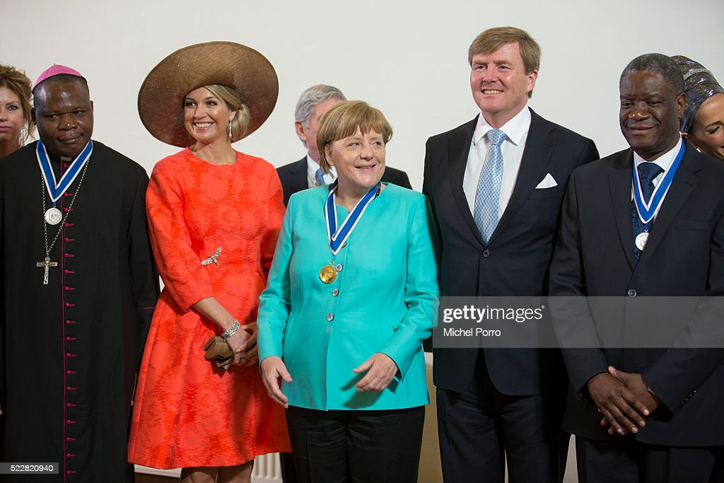 Dieudonne Nzapalainga, Queen Maxima of The Netherlands, German Chancellor <a gi-track='captionPersonalityLinkClicked' href=/galleries/search?phrase=Angela+Merkel&family=editorial&specificpeople=202161 ng-click='$event.stopPropagation()'>Angela Merkel</a>, <a gi-track='captionPersonalityLinkClicked' href=/galleries/search?phrase=King+Willem-Alexander&family=editorial&specificpeople=160214 ng-click='$event.stopPropagation()'>King Willem-Alexander</a> of The Netherlands and <a gi-track='captionPersonalityLinkClicked' href=/galleries/search?phrase=Denis+Mukwege&family=editorial&specificpeople=5127888 ng-click='$event.stopPropagation()'>Denis Mukwege</a> pose for a group photo after the Four Freedoms Awards ceremony on April 21, 2016 in Middelburg, Netherlands.