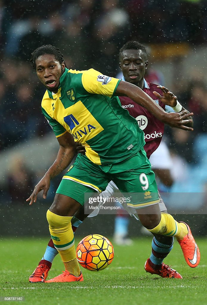 <a gi-track='captionPersonalityLinkClicked' href=/galleries/search?phrase=Dieumerci+Mbokani&family=editorial&specificpeople=4528520 ng-click='$event.stopPropagation()'>Dieumerci Mbokani</a> of Norwich City and <a gi-track='captionPersonalityLinkClicked' href=/galleries/search?phrase=Aly+Cissokho&family=editorial&specificpeople=4302605 ng-click='$event.stopPropagation()'>Aly Cissokho</a> of Aston Villa compete for the ball during the Barclays Premier League match between Aston Villa and Norwich City at Villa Park on February 6, 2016 in Birmingham, England.