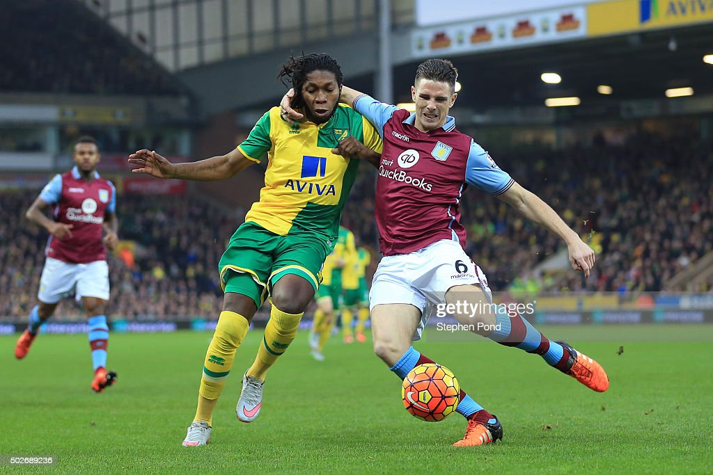 <a gi-track='captionPersonalityLinkClicked' href=/galleries/search?phrase=Dieumerci+Mbokani&family=editorial&specificpeople=4528520 ng-click='$event.stopPropagation()'>Dieumerci Mbokani</a> of Norwich City and <a gi-track='captionPersonalityLinkClicked' href=/galleries/search?phrase=Ciaran+Clark&family=editorial&specificpeople=4644641 ng-click='$event.stopPropagation()'>Ciaran Clark</a> of Aston Villa compete for the ball during the Barclays Premier League match between Norwich City and Aston Villa at Carrow Road on December 28, 2015 in Norwich, England.