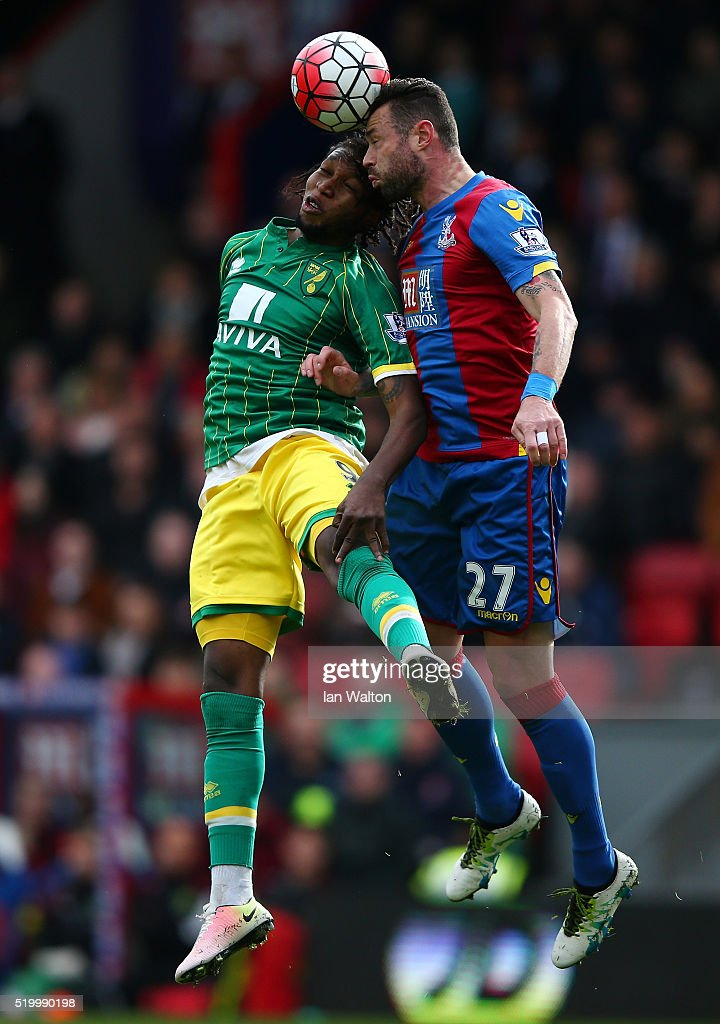 <a gi-track='captionPersonalityLinkClicked' href=/galleries/search?phrase=Dieumerci+Mbokani&family=editorial&specificpeople=4528520 ng-click='$event.stopPropagation()'>Dieumerci Mbokani</a> of Norwich City and Damien Delaney of Crystal Palace compete for the ball during the Barclays Premier League match between Crystal Palace and Norwich City at Selhurst Park on April 9, 2016 in London, England.