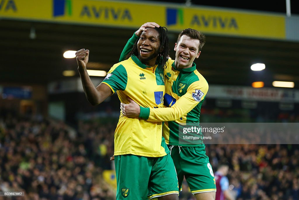 Dieumerci Mbokani of Norwich City celebrates scores his team's second goal with his team mate Jonathan Howson during the Barclays Premier League...