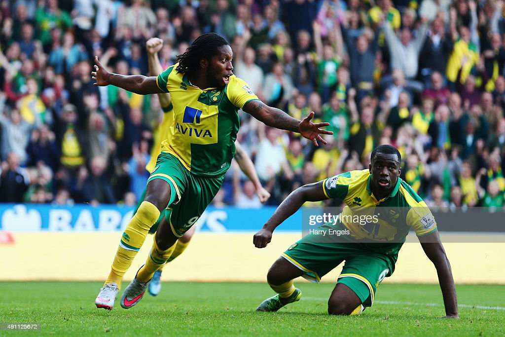 <a gi-track='captionPersonalityLinkClicked' href=/galleries/search?phrase=Dieumerci+Mbokani&family=editorial&specificpeople=4528520 ng-click='$event.stopPropagation()'>Dieumerci Mbokani</a> (L) of Norwich City celebrates scoring his team's first goal during the Barclays Premier League match between Norwich City and Leicester City at Carrow Road on October 3, 2015 in Norwich, United Kingdom.