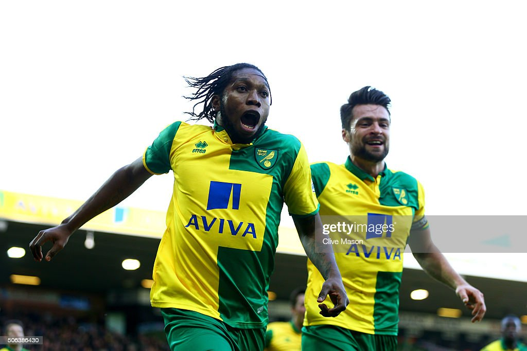 <a gi-track='captionPersonalityLinkClicked' href=/galleries/search?phrase=Dieumerci+Mbokani&family=editorial&specificpeople=4528520 ng-click='$event.stopPropagation()'>Dieumerci Mbokani</a> (L) of Norwich City celebrates scoring his team's first goal with his team mate Russel Martin (R) during the Barclays Premier League match between Norwich City and Liverpool at Carrow Road on January 23, 2016 in Norwich, England.