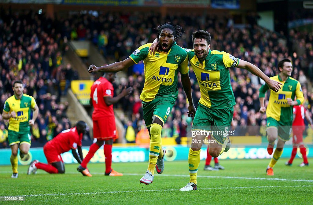 <a gi-track='captionPersonalityLinkClicked' href=/galleries/search?phrase=Dieumerci+Mbokani&family=editorial&specificpeople=4528520 ng-click='$event.stopPropagation()'>Dieumerci Mbokani</a> (C) of Norwich City celebrates scoring his team's first goal with his team mate Russel Martin (R) during the Barclays Premier League match between Norwich City and Liverpool at Carrow Road on January 23, 2016 in Norwich, England.