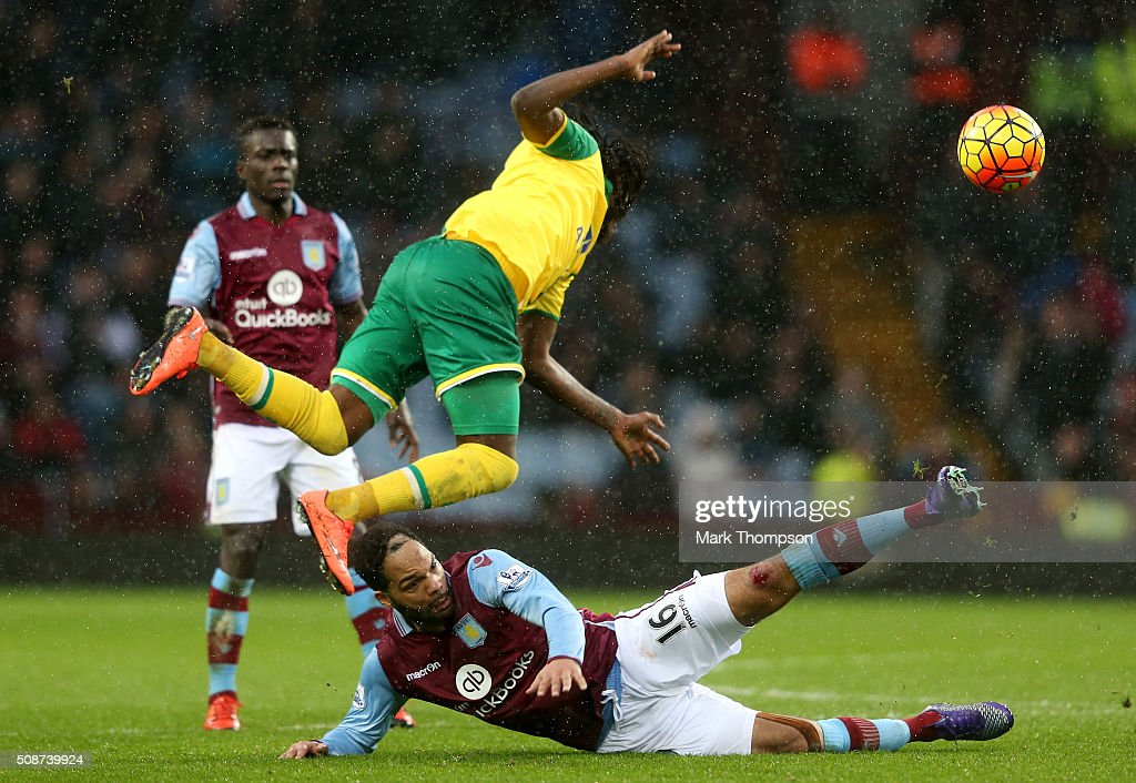 <a gi-track='captionPersonalityLinkClicked' href=/galleries/search?phrase=Dieumerci+Mbokani&family=editorial&specificpeople=4528520 ng-click='$event.stopPropagation()'>Dieumerci Mbokani</a> of Norwich City is tackled by <a gi-track='captionPersonalityLinkClicked' href=/galleries/search?phrase=Joleon+Lescott&family=editorial&specificpeople=687246 ng-click='$event.stopPropagation()'>Joleon Lescott</a> of Aston Villa during the Barclays Premier League match between Aston Villa and Norwich City at Villa Park on February 6, 2016 in Birmingham, England.