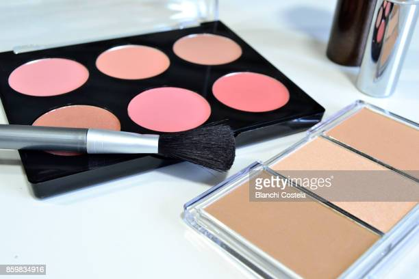 Different blush and makeup bases on white background