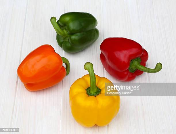 Different coloured bell peppers in circle