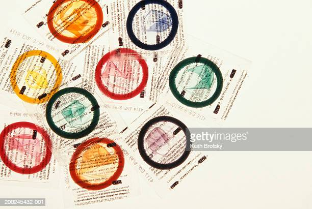 9 different coloured condoms