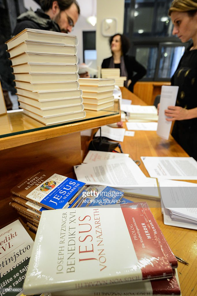 "Different editions of Pope Benedict XVI's new book ""Childhood of Jesus"" are displayed during the presentation of the book to the press on November 20, 2012 at the Vatican. ""Childhood of Jesus"" is the third volume of Joseph Ratzinger's 'Jesus of Nazareth' series. AFP PHOTO / ANDREAS SOLARO"