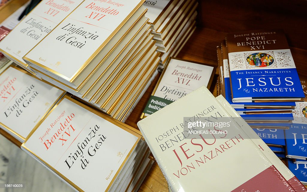"Different editions of Pope Benedict XVI's new book ""Childhood of Jesus"" are displayed during the presentation of the book to the press on November 20, 2012 at the Vatican. ""Childhood of Jesus"" is the third volume of Joseph Ratzinger's 'Jesus of Nazareth' series."