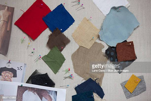 Different fabric swatches on a pin board
