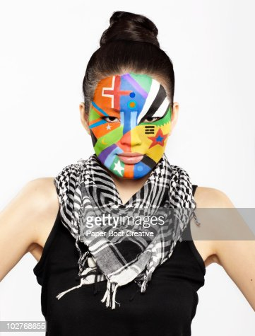 Different flag designs painted on woman's face