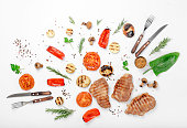 Different food grilled on a white background. Top view. Flat lay