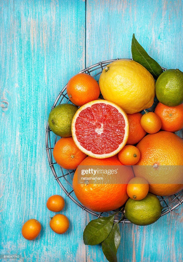Different fresh citrus fruit : Stock Photo