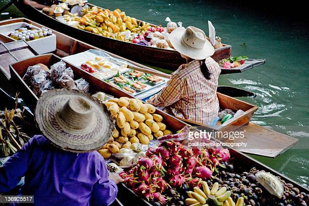 Different fruits on sale on boats