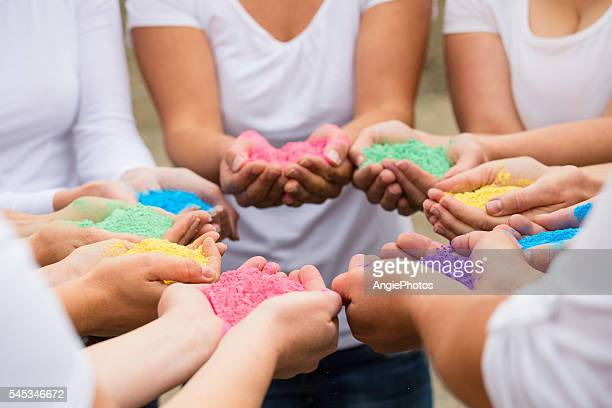 Different holi colors in hands